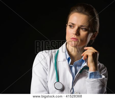 Portrait Of Thoughtful Medical Doctor Woman Looking On Copy Spac