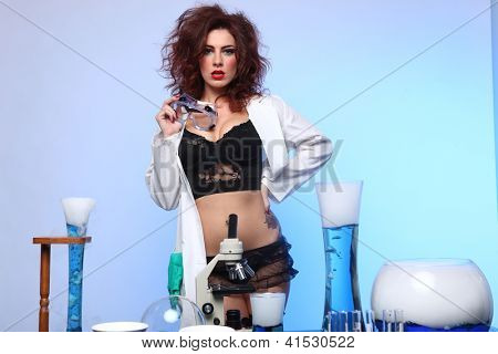 Exaggerated Science Student in Sexy Clothing Experimenting