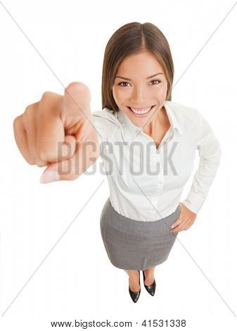 Positive business woman pointing her finger at camera isolated on white on white background, standing smiling happy in high angle. Mixed race Asian Caucasian business woman.