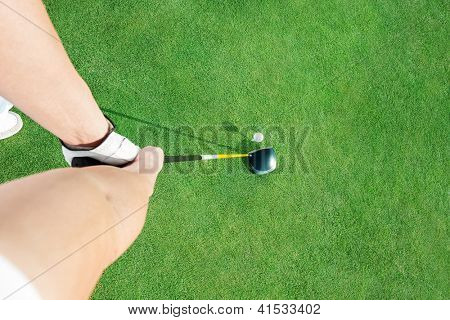 Golf club and golf ball  ready to putting ball, top view