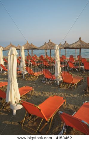 Deck Chairs And Beach Umbrellas