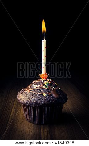 Muffin With Burning Candle