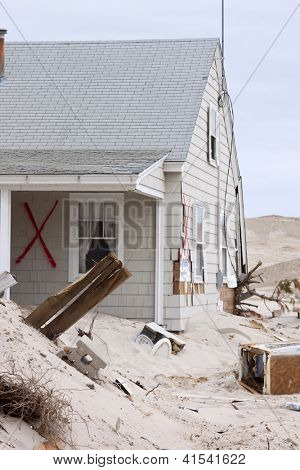 CHADWICK, NJ - JAN 13: A red X spray painted on a destroyed home on January 13, 2013 in Chadwick, New Jersey. Clean up continues 75 days after Hurricane Sandy struck the shore in October 2012.