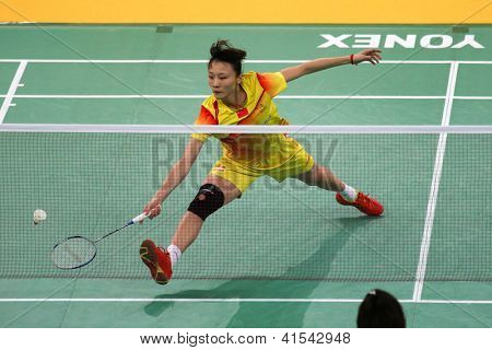 KUALA LUMPUR - JANUARY 15: China's Yao Xue retrieves the shuttlecock during her qualifying match at the Maybank Malaysia Open 2013 Badminton event on January 15, 2013 in Kuala Lumpur, Malaysia.