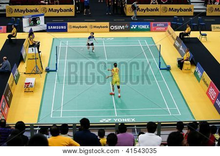 KUALA LUMPUR - JANUARY 15: China's Yao Xue (yellow) takes on Vietnam's Vu Thi Trang in a match at the Maybank Malaysia Open 2013 Badminton event on January 15, 2013 in Kuala Lumpur, Malaysia.