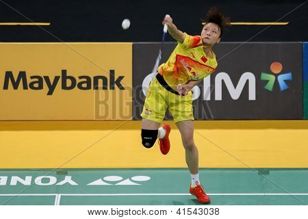 KUALA LUMPUR - JANUARY 15: China's Yao Xue smashes the shuttlecock during her qualifying match at the Maybank Malaysia Open 2013 Badminton event on January 15, 2013 in Kuala Lumpur, Malaysia.