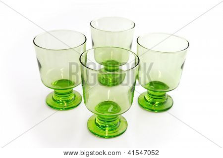 Four matching green goblets
