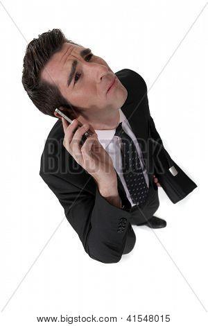 Businessman taking a bad phone call