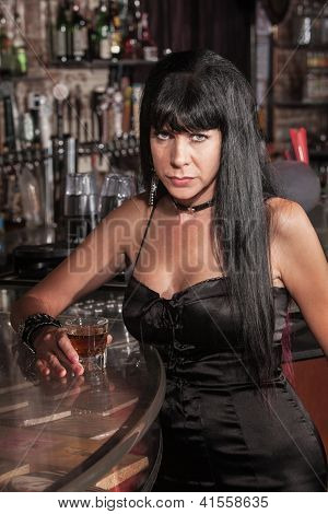 Serious Pretty Woman At Bar