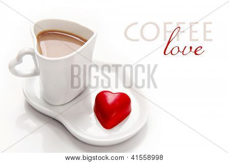 Valentine's Day morning coffee with red heart chocolate on white background