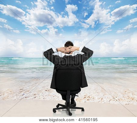 Young businessman relaxing on the beach. Conceptual background.