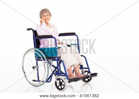 elegant senior woman sitting on wheelchair isolated on white