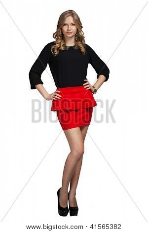 Glamour girl in red skirt on white