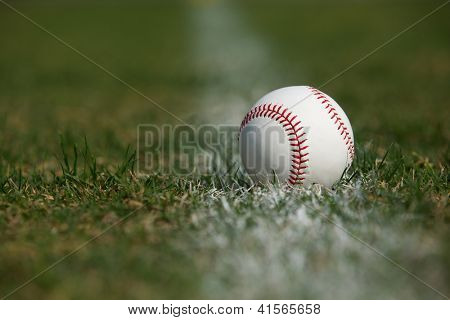 Baseball in the Outfield Grass and Chalk Line