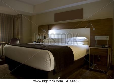 King-Size Bed With Bedside Tables Lamps