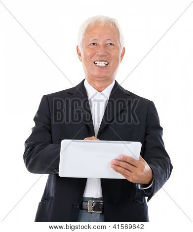Senior adult Asian Chinese boss using tablet-pc standing over white background