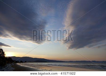 Sunset on the beach of Marlborough Sounds New Zealand
