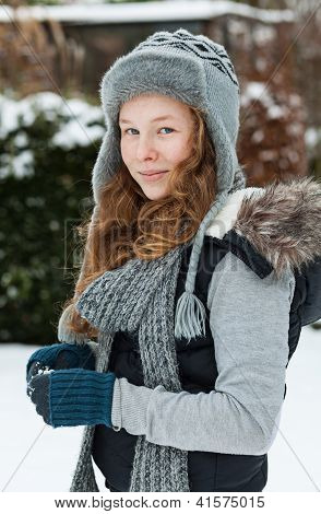 Teenager Girl Holding Snowball