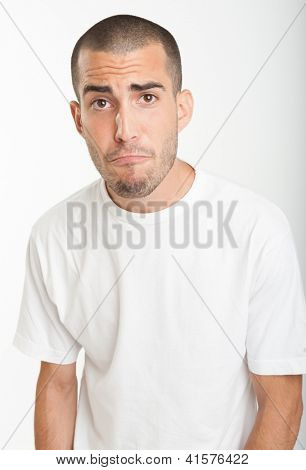 Portrait of a young man with a pleading expression