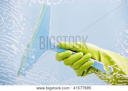 Cleaning - cleaning  pane with detergent, spring cleaning concept