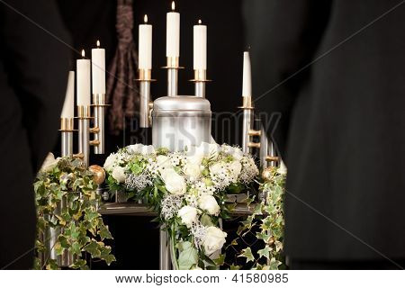 Religion, death and dolor - funeral and cemetery; urn funeral
