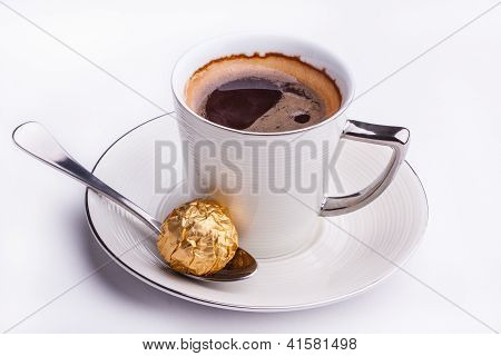 Black Coffee Served With Sweet Chocolate.