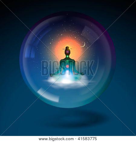 Meditating silhouette sitting lotus position in sphere.