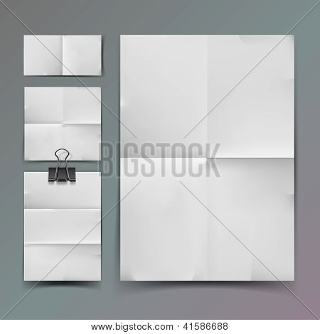 White folded paper set and paperclip