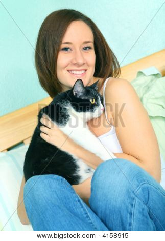 Beautiful Young Caucasian Female With Cute Cat