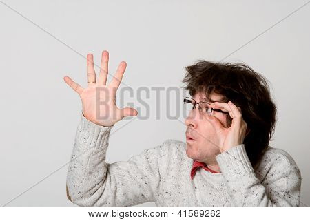 Man With Disheveled Hair Pointing  Hand At Something Interesting