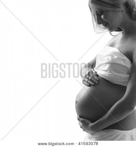 Young and beautiful pregnant woman in antique dress over white  background with a lot of blank space