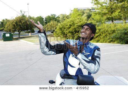 Motorcycle Biker Raises Hands Up And Presents...