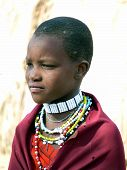Young Masai girl in traditional dress and jewellery