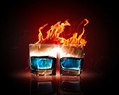stock photo of absinthe  - Image of two glasses of burning emerald absinthe - JPG