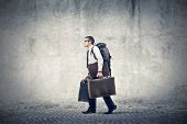 stock photo of heavy bag  - Office worker with a travel backpack and two briefcases - JPG