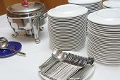 picture of chafing  - photograph of plates cutleries and chafing dish at catering buffet - JPG