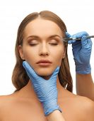 foto of scalpels  - picture of woman face and beautician hands with scalpel - JPG