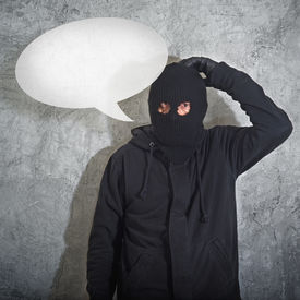 picture of shoplifting  - Confused burglar with speech balloonconcept thief with balaclava caught confused and without idea in front of the grunge concrete wall - JPG