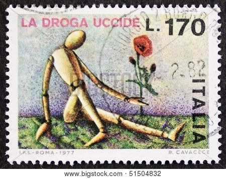 ITALY - CIRCA 1977: a stamp printed in Italy promote a campaign against drugs and addiction. Italy, circa 1977