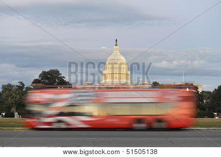 Washington DC, double deck tour bus in motion blur in front of US Capitol Building