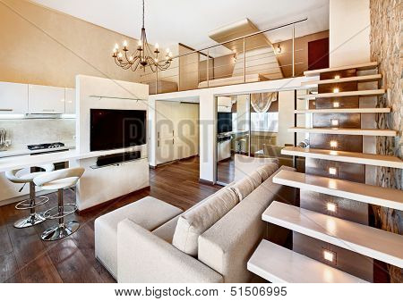 Modern minimalism style two-high drawing-room interior with staircase in beige tones