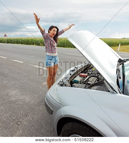 Woman Having Problem With Broken Car