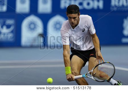 KUALA LUMPUR - SEPTEMBER 27: Joao Sousa volleys a return to David Ferrer during a quarter-final match at the Malaysia Open 2013 tennis played at the Putra Stadium, Malaysia on September 27, 2013.