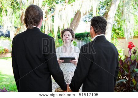 Young female minister uses a tablet PC to perform a gay marriage ceremony.