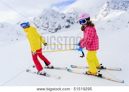 Ski, skiers on ski run - child skiing downhill, ski lesson