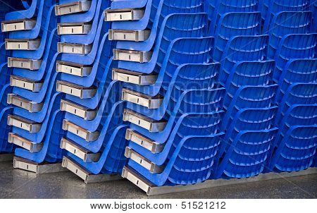 Ordered Conglomeration Of Blue Plastic Seats