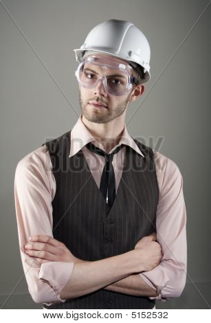 Young Man In Hard Hat And Safety Goggles
