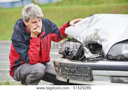 Adult upset driver man in front of automobile crash car collision accident in city