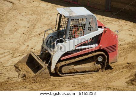 Mini Excavator On Construction Site