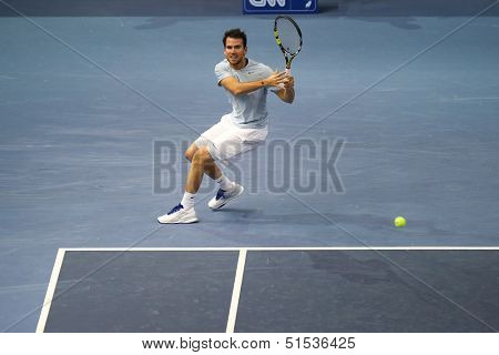 KUALA LUMPUR - SEPTEMBER 25: Adrian Mannarino (France) hits a backhand return in a first round tennis match at the Malaysia Open 2013 played at the Putra Stadium, Malaysia on September 25, 2013.